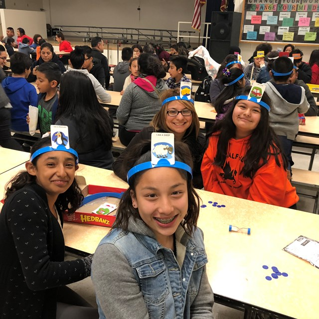 Students have a blast as they use their educated guesses in a game of Hedbanz!